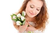 Happy woman holding white tulips — Stock Photo