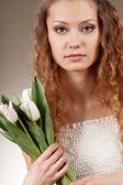 Woman holding tulips — Stock Photo