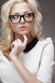 Portrait of blonde woman wearing eyeglasses — Stock Photo