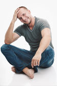 Strong casually dressed man — Stock Photo
