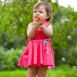 Cute little girl stading on meadow — Stock Photo