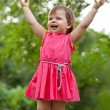 Little girl rising up her hands — Stock Photo