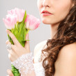 Bride portrait with bouquet of tulips — Stock Photo