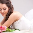 Studio photograph of a bride lying on the floor — Stock Photo