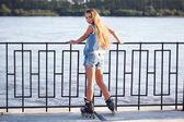 Girl on roller skates — Stock Photo