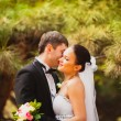 Bride and groom outdoors portrait - Stock Photo