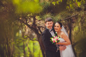 Bride and groom outdoors portrait — Stock Photo