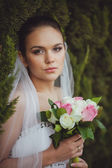 Bride portrait over green trees outdoor — Stock Photo