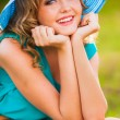 Happy blonde woman wearing hat — Stock Photo