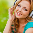 Closeup woman face with headphones — Stock Photo
