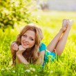 Happy blonde woman at park — Stock Photo