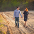 Couple walking along the dirt road — Stock Photo