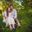 Couple in love sitting at summer park — Stock Photo
