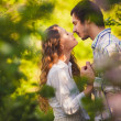 Stock Photo: Couple in love kissing at summer park