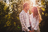 Happy couple walking at park — Stock Photo