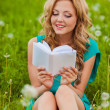 Serious woman reading book outdoors — Stock Photo #29292681