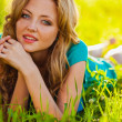 Blonde woman at park — Stock Photo