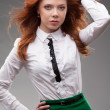 Red-haired businesswoman portrait over gray — Stock Photo #29292723