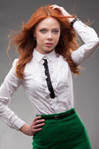Red-haired businesswoman portrait over gray — Stock fotografie