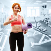 Woman holding fitness mat — Stock Photo
