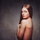 Beautiful woman with naked back portrait — Stock Photo