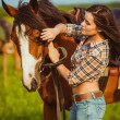 Woman posing with horse — Stock Photo #30095321