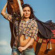 Woman posing with horse — Stock Photo #30095355