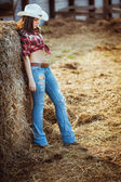 Cowgirl model posing on farm — Stock Photo