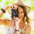 Happy young girl with camera outdoors — Stock Photo