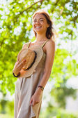 Happy girl walking in the summer park — Stock Photo