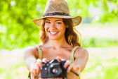 Happy young girl with camera outdoors — Stok fotoğraf