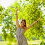 Happy girl wearing hedphones outdoors — Stock Photo #31252537