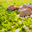 Woman lying on grass — Stock Photo #31252561