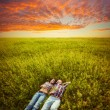 Couple lying on the grass — Foto Stock