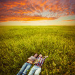 Couple lying on the grass — Stock Photo #31867637