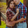 Couple on the farm stading near fence — Stock Photo #31868003