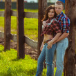Couple on the farm stading near fence — 图库照片