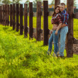 Couple on the farm stading near fence — Stock Photo #31868019