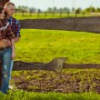 Couple on the farm stading near fence — Stock Photo