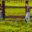 Couple on the farm stading near fence — Stock Photo #31868041