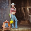 Young adult woman posing on farmland — Stock Photo