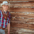Cowboy style man on stable — Stock Photo