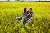 Couple sitting on the grass — Stock Photo
