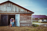 Couple standing near stable — Stock Photo