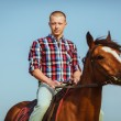 Cowboy style man riding horse — Stock Photo