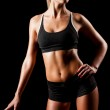 Sports woman over black — Stock Photo
