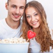 Couple with pop corn — Stockfoto