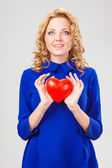 Woman holding heart — Stock fotografie