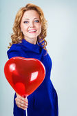 Blonde woman holding ballons — Stock Photo