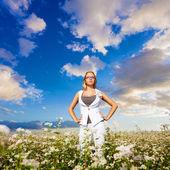 Businesswoman standing on flowers field — Stock Photo